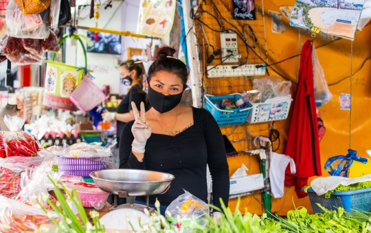 Women wearing mask selling on the market during the COVID-19 coronavirus outbreak in Thailand