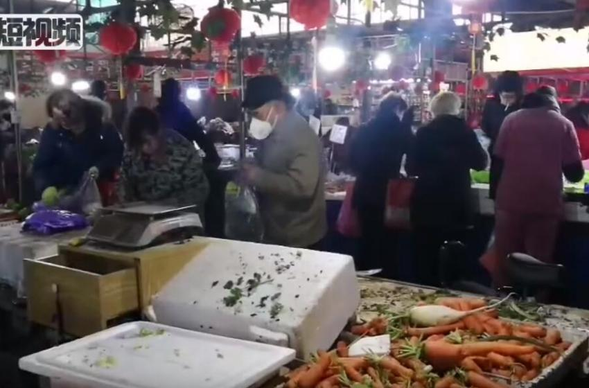 Wuhan citizens in China buying vegetables during Wuhan coronavirus outbreak
