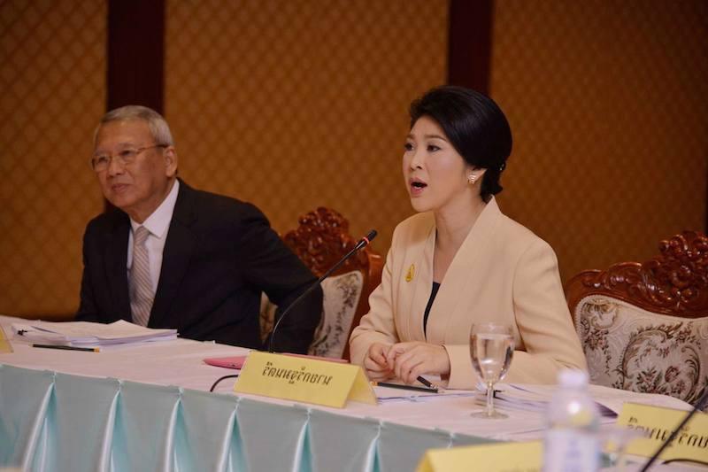 Yingluck Shinawatra and Niwatthamrong Boonsongpaisan