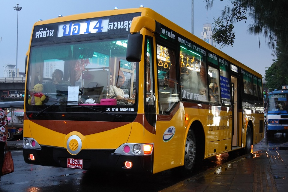 Yellow bus in Bangkok, Thailand. Zhong Tong chassis, bodywork by Thonburi Bus Body Co., Ltd.