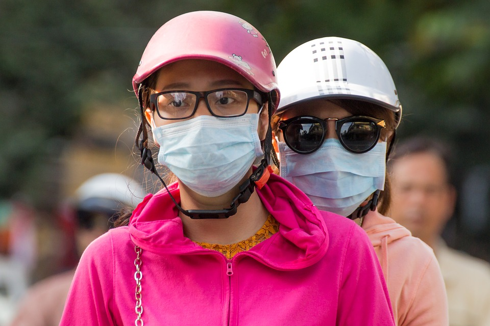 Asian people wearing face masks