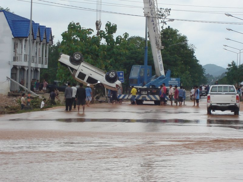 Crane at the site of a road accident due heavy floods in Uttaradit