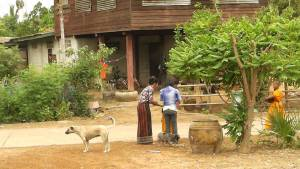 Women outside a house in Northeastern Thailand (Isan)