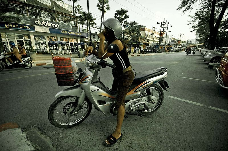 Thai girl riding a Yamaha