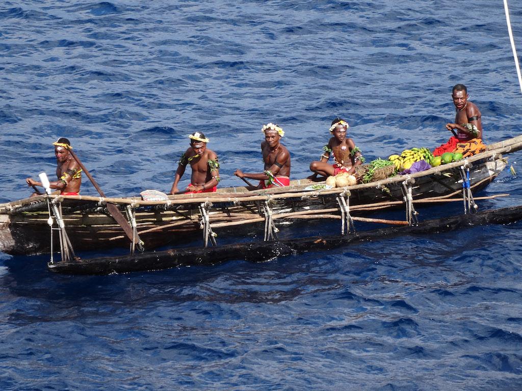 Natives in a boat in Papua New Guinea