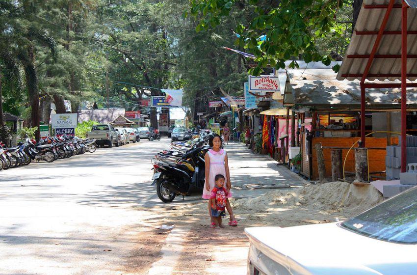 Girl posing on a road in Phuket