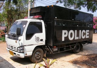 Isuzu NKR Prisoner transport vehicle of the Royal Thai Police, at Na Wa Police station, Thailand