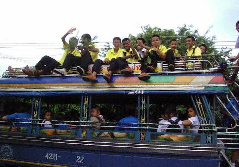 Bus transporting children home from school in Yasothon