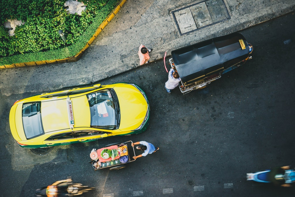 Aerial view of a taxi, yuk tuk and other vehicles in Bangkok