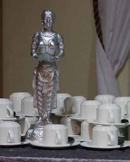 Silver welcome lady centerpiece