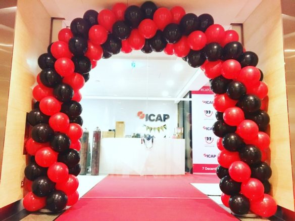red-and-black-spiral-balloon-arch