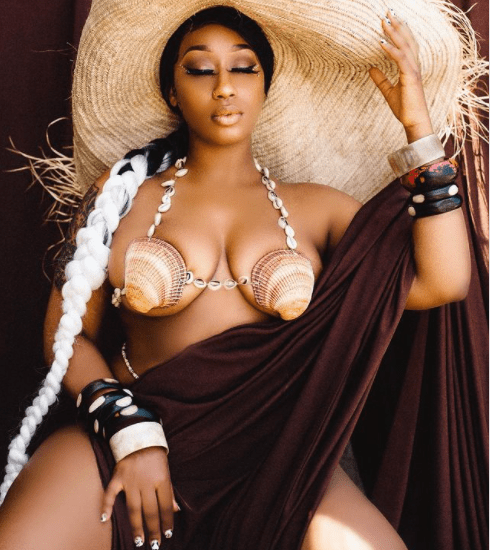 Victoria Kimani's boobs threaten to spill out of revealing shell and cowries bra