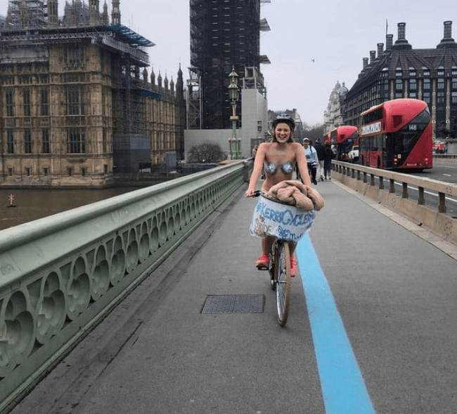 Woman cycles around London without clothes for charity after flatmate's dare