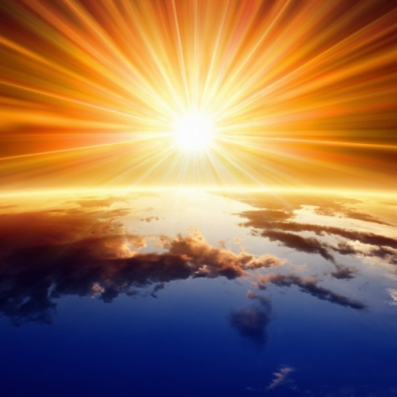 23744027 - abstract religious backgrounf - bright sun shines above planet earth