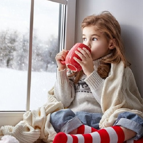 Hygge girl drinking from mug