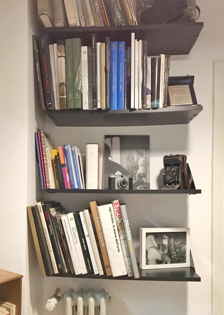 airbnb torino italy interior hallway shelf