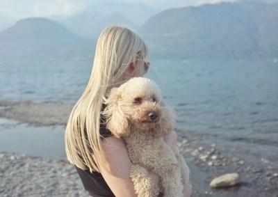 lake sunday italy hygge dog hug