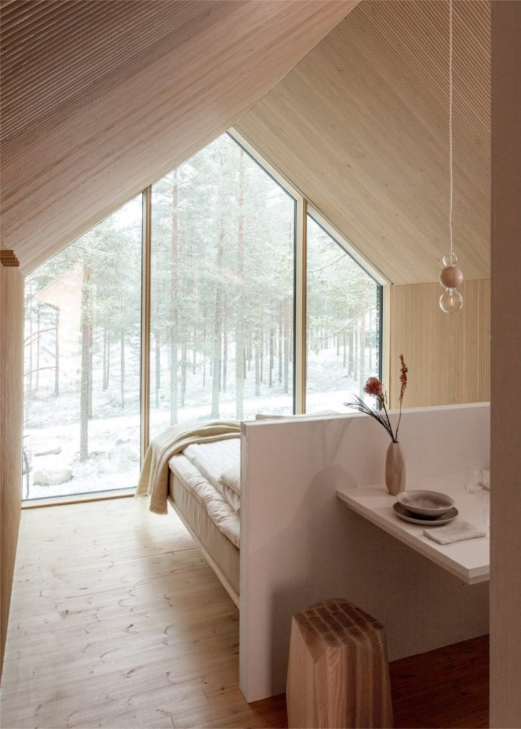 that scandinavian feeling cozy cabin finland interior bed