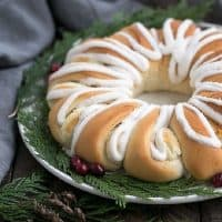 Cream Cheese Tea Roll on a white plate garnished for Christmas