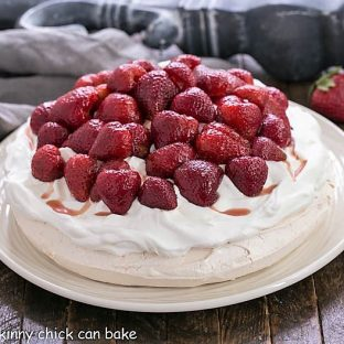 Strawberry Pavlova side view on a white platter