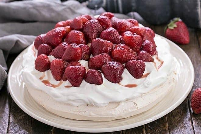 Strawberry Pavlova side view on a white platter