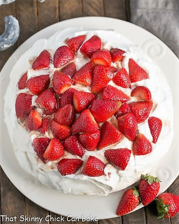 Overhead view of a Strawberry Pavlova on a white serving plate