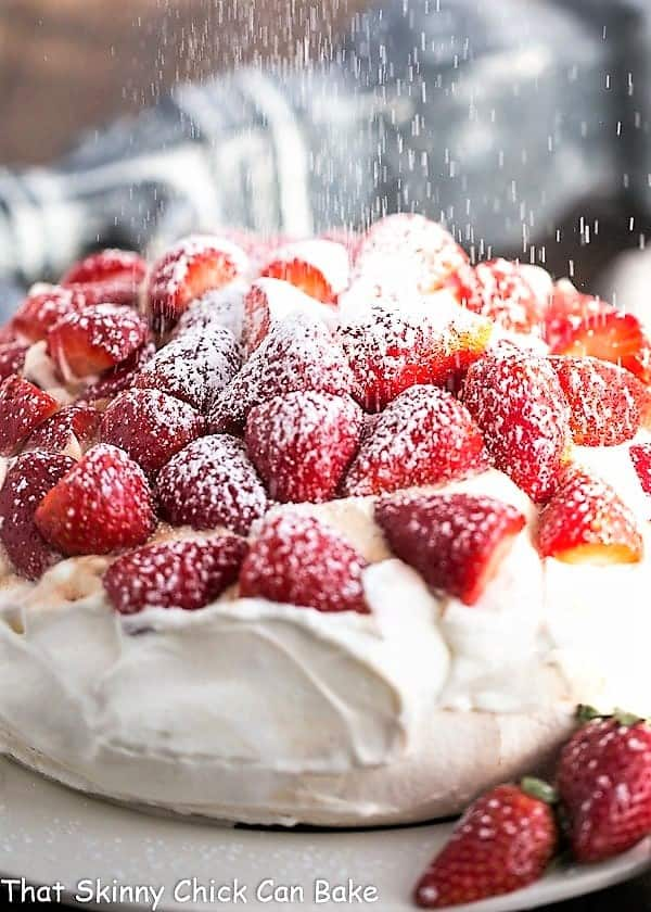 Strawberry Pavlova dusted with powdered sugar
