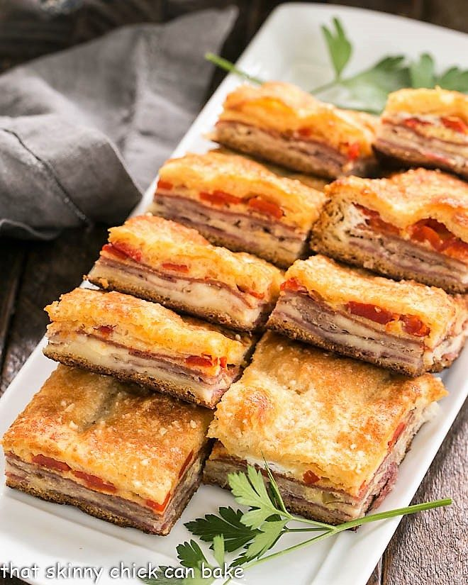 Antipasto Squares lined up on a rectangular platter
