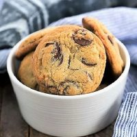 Famous NYT chocolate chip cookies in a white ceramic bowl