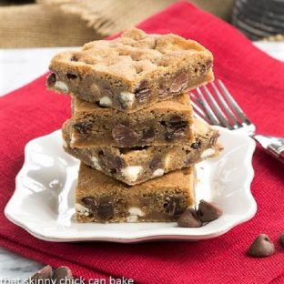 Chocolate Chip Cookie Bars stacked on a square white plate