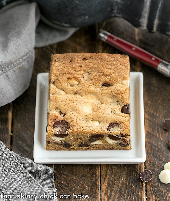 One chocolate chip cookie bars on a square white plate