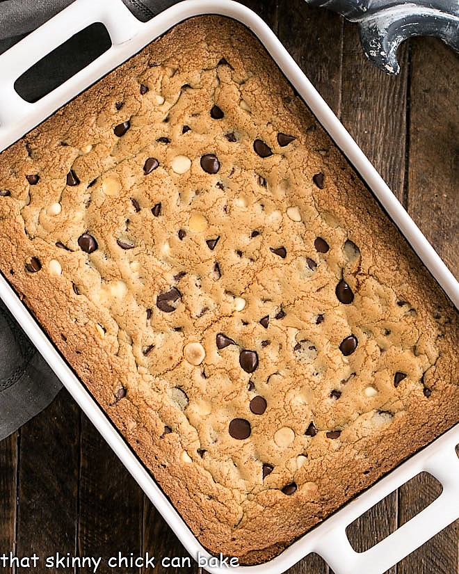 Overhead view of baked cookie bars in a white ceramic baking pan