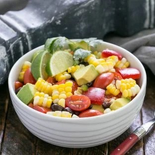 Avocado corn salad in a small serving bowl