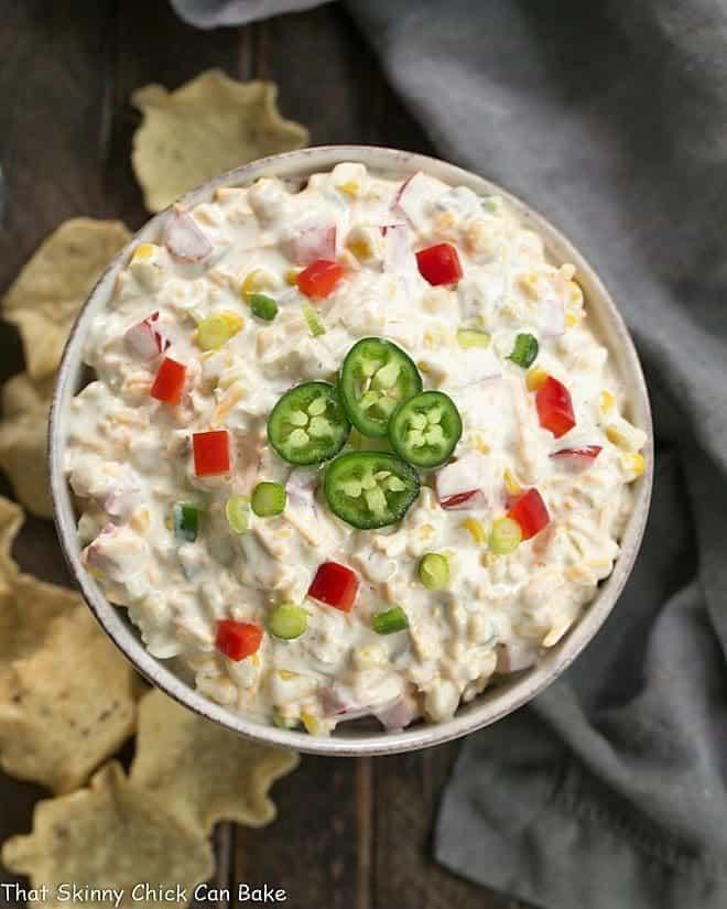 Overhead view of Sour Cream Corn Dip in a round ceramic dish