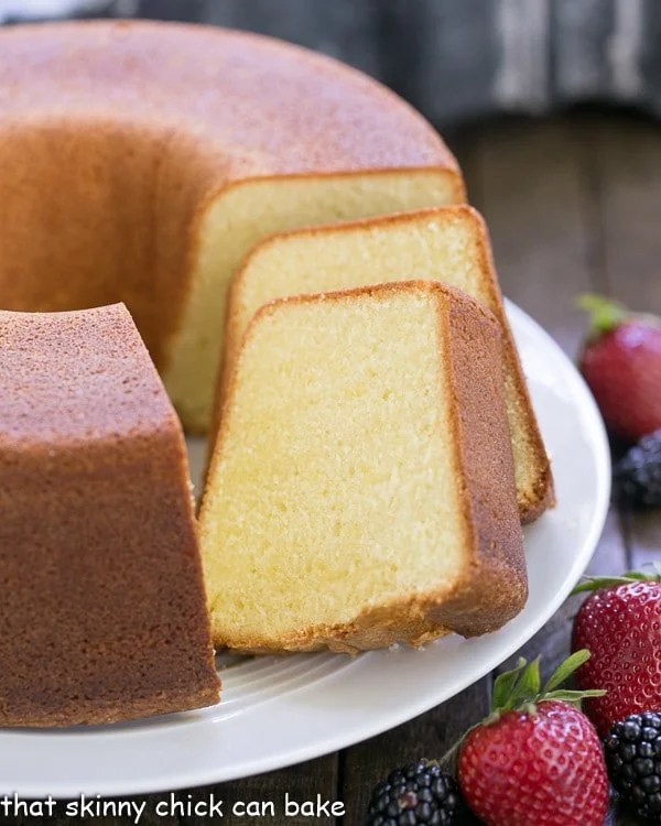 The Best Pound Cake and slices on a cake plate