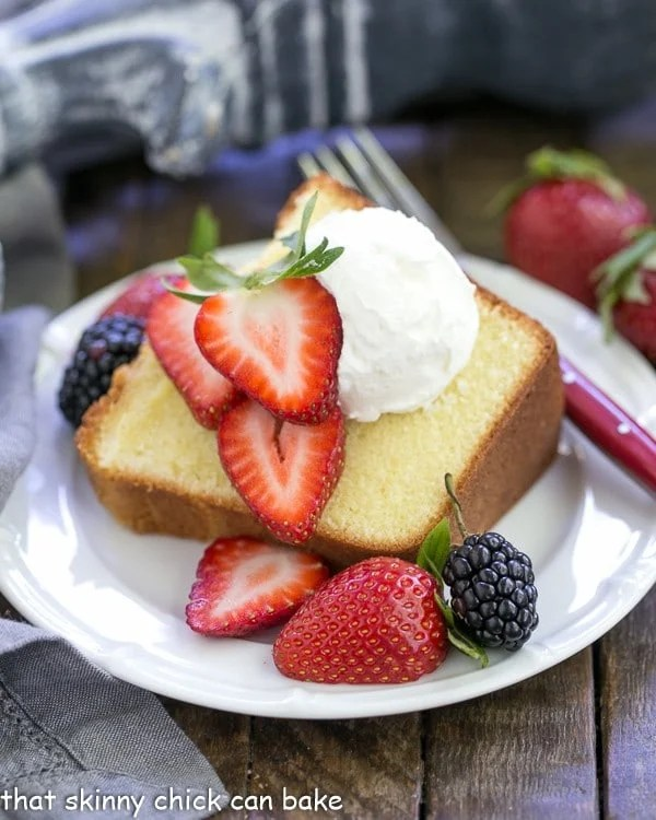 The Best Pound Cake | Dense, yet tender and delicious! Perfect topped with berries and cream!