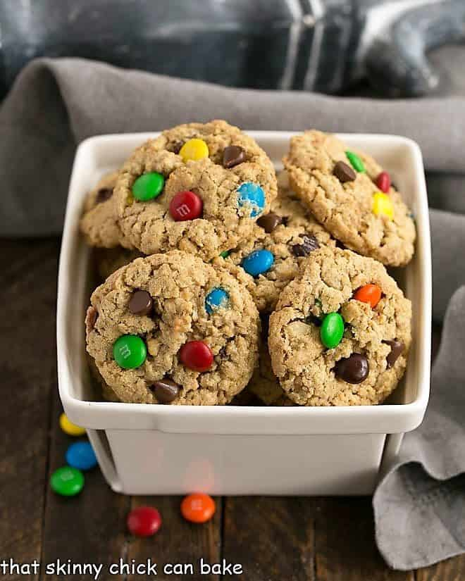 Classic Monster Cookies piled in a ceramic basket