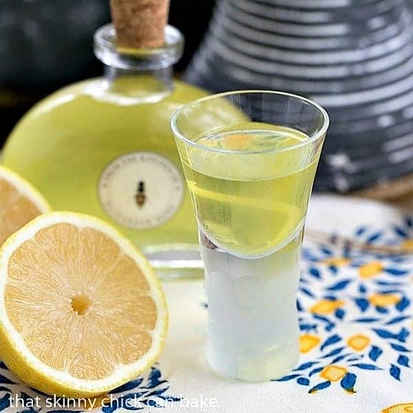 A shot glass filled with Homemade Limoncello Liqueur