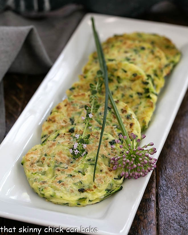 zucchini fritters on a white rectangle tray