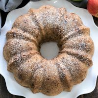 Overhead view of apple bundt cake on a white plate