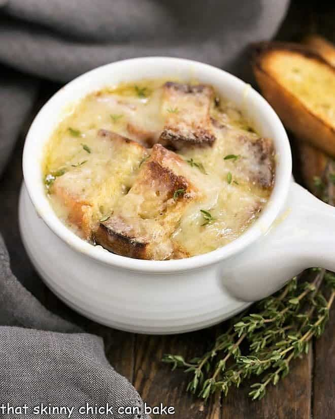 Classic French Onion Soup in a white ceramic soup bowl