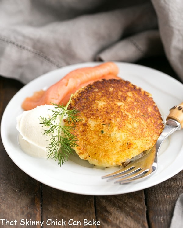 Gruyere Potato Cakes with smoked salmon on a small white plate