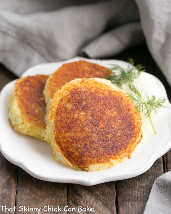Gruyere Potato Cakes on a decorative white plate