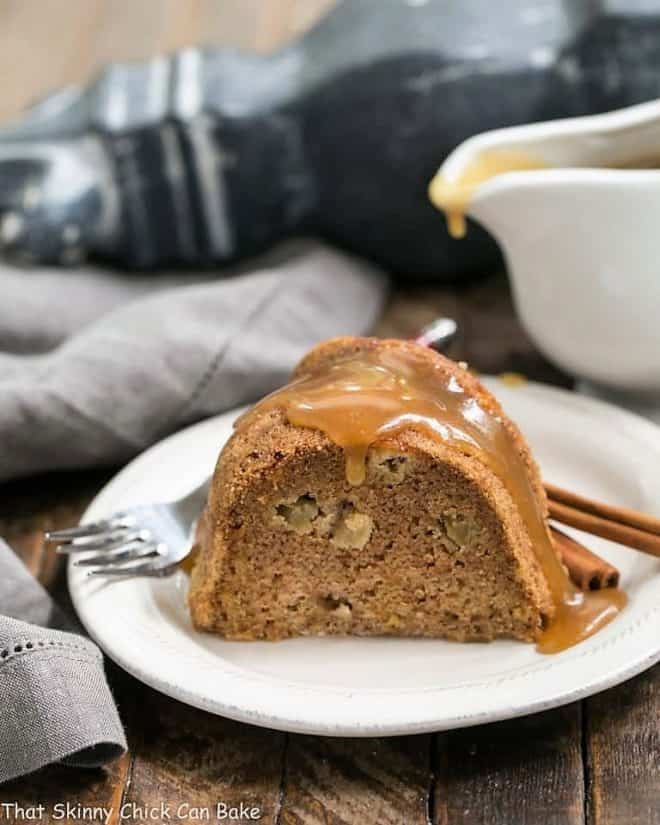 Apple Cake with Brown Sugar Caramel Sauce on a white dessert plate