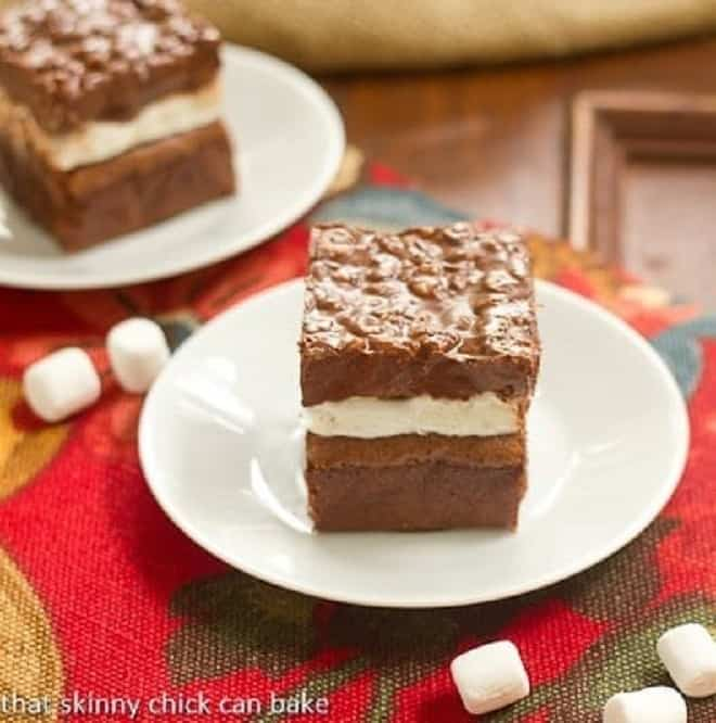 Peanut Butter Krispie Topped Brownies on white plates viewed from the side