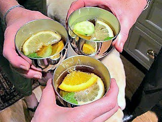 Toasting with Pimm's Cup in pewter cups