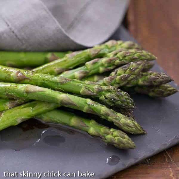 Oven Roasted Asparagus with Balsamic Brown Butter on a slate serving platter