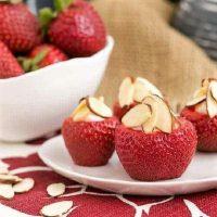 Cheesecake stuffed strawberries on a small white plate