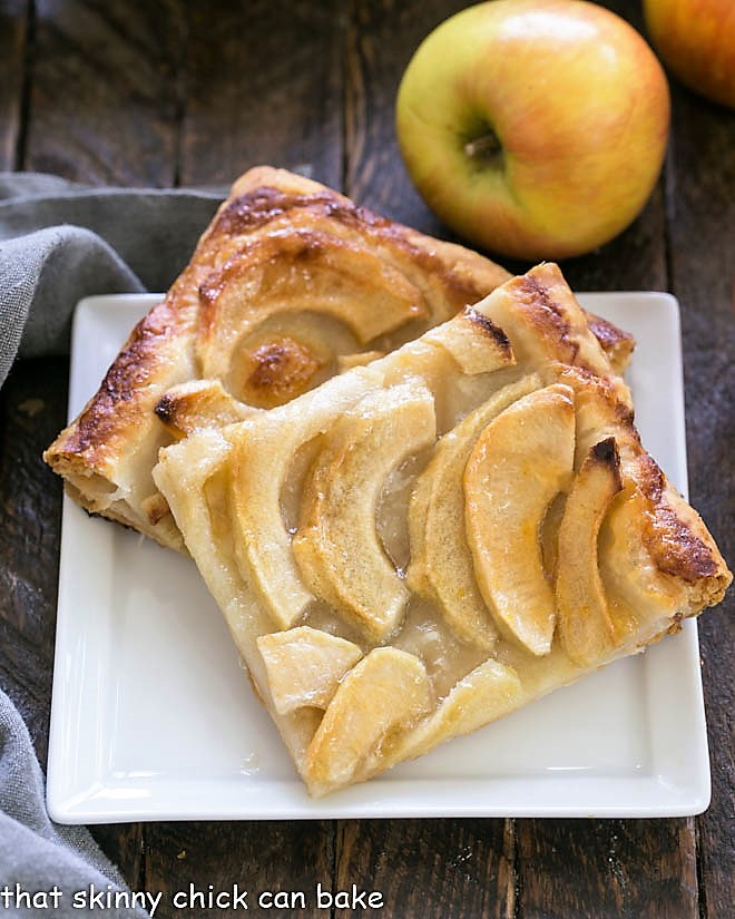 Easy, buttery French Apple Tart with Puff Pastry slices on a dessert plate