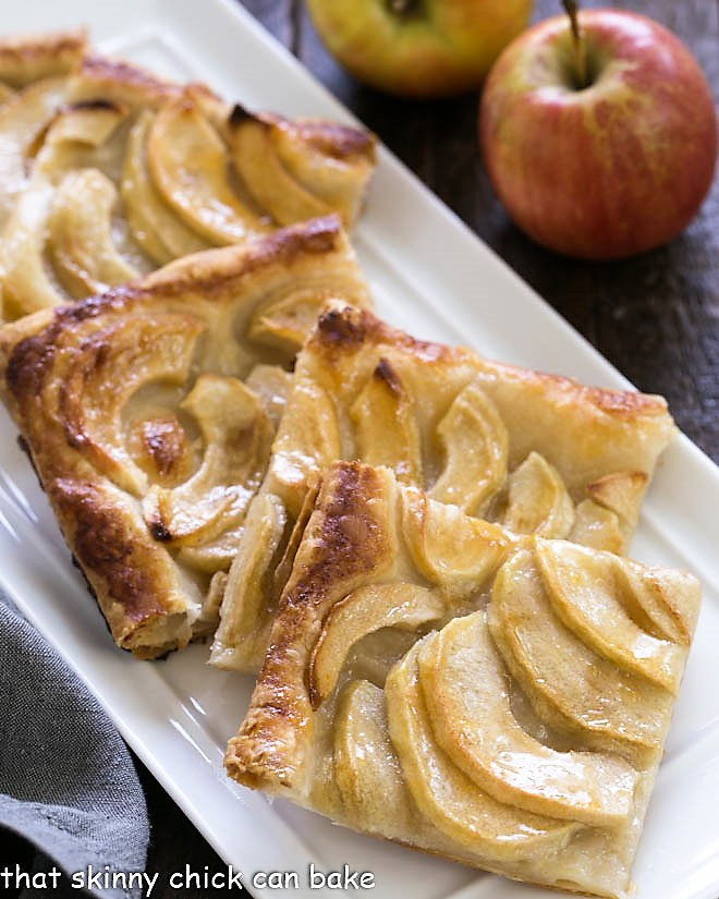 Slices of French Apple Tart on a white ceramic tray